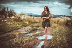 Girl going on rural road Royalty Free Stock Image