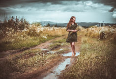 Girl going on rural road Royalty Free Stock Images