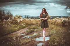 Girl going on rural road Stock Photo