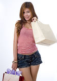 Girl going shopping in her shorts Stock Photography
