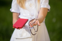 Girl going to the first holy communion Royalty Free Stock Image