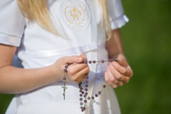 Girl going to the first holy communion Stock Photos