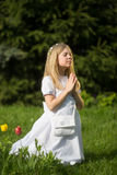 Girl going to the first holy communion. Girl on the day of Holy Communion Stock Photo