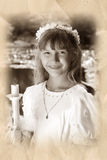 Girl going to the first holy communion in sepia Stock Photography