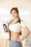Girl going to gym. With towel, gourd and clipboard in hand, smiling at camera confidently Royalty Free Stock Photos