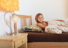 Girl going to sleep Stock Images