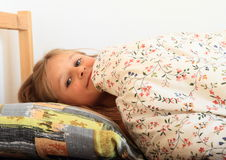 Girl going to sleep Stock Photos