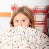 Girl going to sleep Royalty Free Stock Photos