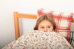 Girl going to sleep Stock Photos