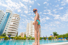Girl is going to swim in the pool. Stock Images