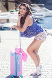 Girl going to vacations with pink suitcase Royalty Free Stock Photo
