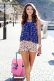 Girl going to vacations with pink suitcase Stock Photos