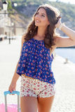Girl going to vacations with pink suitcase Stock Image
