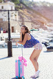 Girl going to vacations with pink suitcase Stock Photography