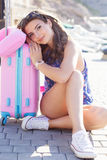 Girl going to vacations with pink suitcase Stock Photo