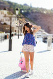 Girl going to vacations with pink suitcase Royalty Free Stock Image