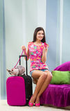 Girl going on vacation with her cat Stock Images