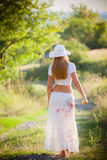 Girl going on the way to rural areas Royalty Free Stock Image
