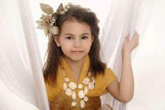 Girl in a gold Stock Images