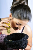 Girl with gold coins Royalty Free Stock Photos