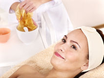 Girl with gold facial mask. Royalty Free Stock Photography