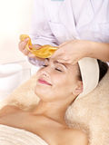 Girl with gold facial mask. Stock Photo