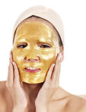 Girl with gold facial mask. Royalty Free Stock Images
