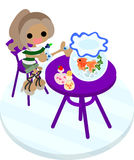 A girl and gold-fish basin. The girl sitting at the purple table which a goldfish basin was put, and eats a candy Stock Photography