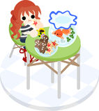 A girl and gold-fish basin. The girl who eats cookies while looking at a goldfish basin on a green table Stock Photos