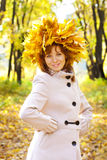 The girl in gold foliage Stock Photo