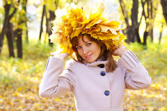 The girl in gold foliage Stock Photos