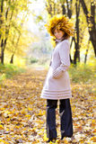 The girl in gold foliage Stock Images