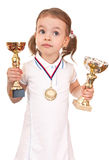 Girl with a gold medal and cups. Royalty Free Stock Photos