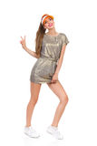 Girl In Gold Mini Dress Showing Peace Sign Royalty Free Stock Photography