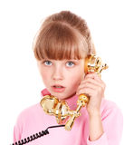 Girl with gold retro telephone. Royalty Free Stock Photography