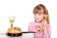 Girl with gold retro telephone. Royalty Free Stock Image