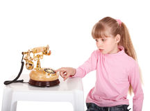 Girl with gold retro telephone. Stock Images