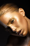 Girl with gold and silver skin in the image of an Oscar. Art image beauty face. Royalty Free Stock Images