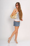 Girl with golden bag Royalty Free Stock Image