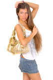 Girl with golden bag Royalty Free Stock Photography