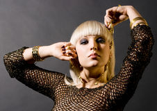 Girl with golden beads Stock Images