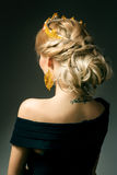 Girl with a golden crown Stock Images