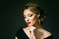 Girl with a golden crown Royalty Free Stock Images