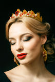 Girl with a golden crown Stock Photography