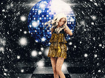 Girl in golden dress on disco Royalty Free Stock Images