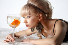 Girl with golden fish Stock Image