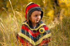 Girl in golden forest Stock Images