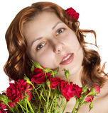 Girl with golden hair with a bouquet of red roses Royalty Free Stock Photos