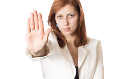 Girl with golden hair shows banning hand gesture Stock Photography