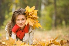 Girl with golden leaves Royalty Free Stock Images